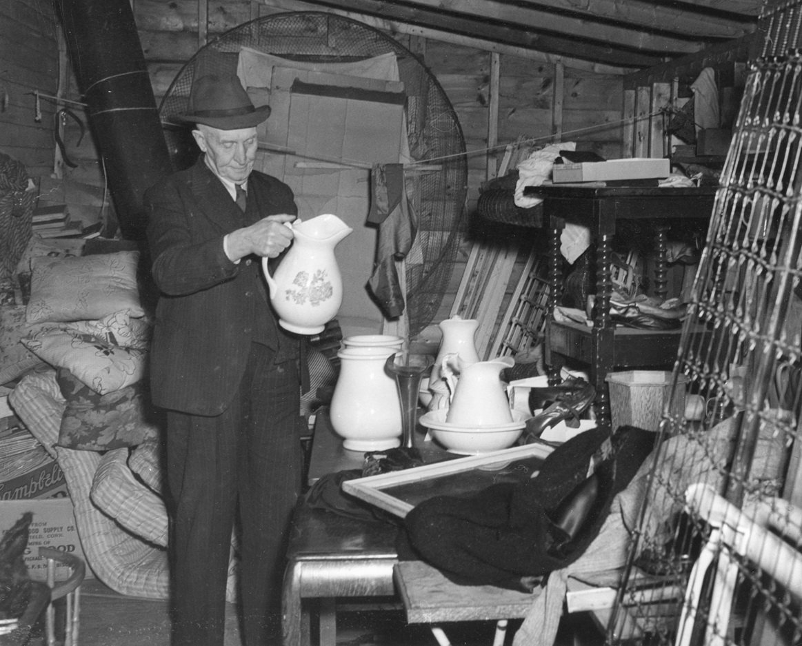 Isaac Ike F. Stanley in his Antique Shop
