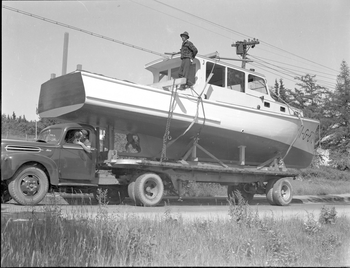 Man and Vessel on Boat Trailer