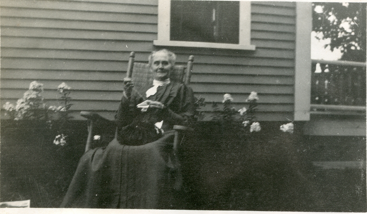 Rebecca (Whitmore) Lurvey Carroll, Mrs. Jacob William Carroll in Rocking Chair at Houlton, Maine