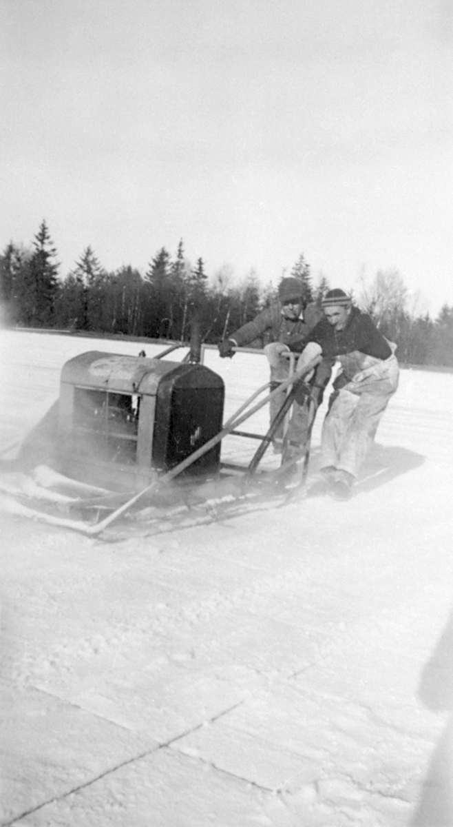 Everett S. Torrey and George A. Noyes with Power Ice Saw
