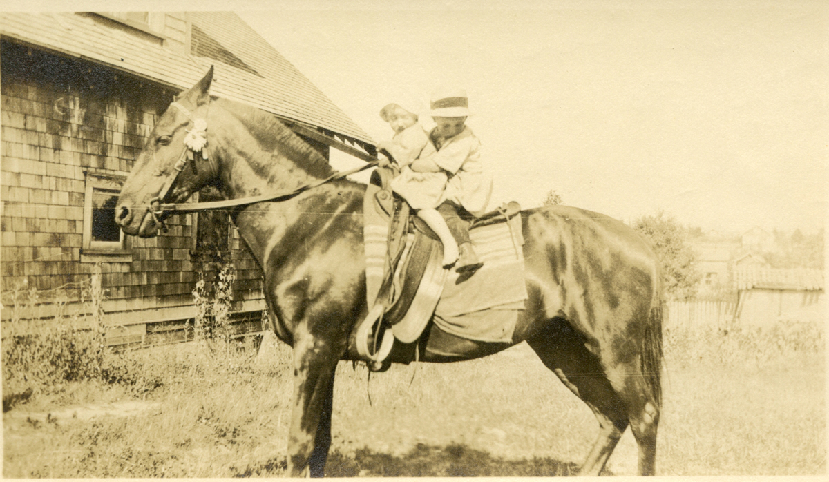 Marion E. Stanley Holding Her Brother, Charles Warren Stanley, on a Horse
