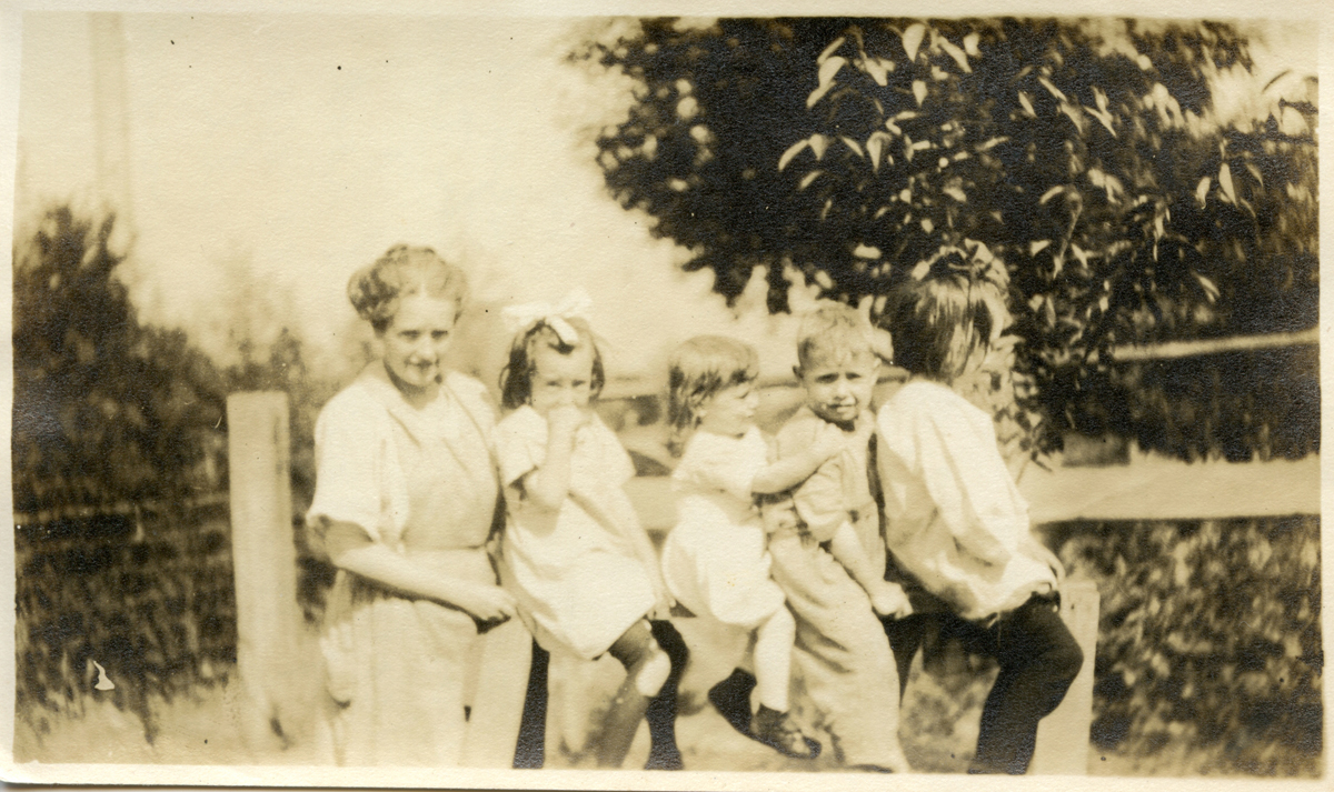 Mabel Florence (Moore) Stanley, Mable Florence Stanley and Marion E. Stanley with Friends on a Sawhorse