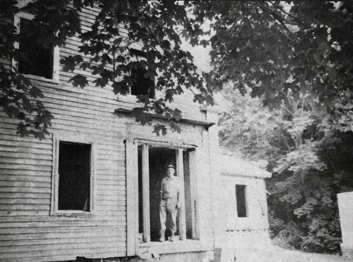 Lester A. Kelley Standing in the Doorway of the Nathan H. Stanley House