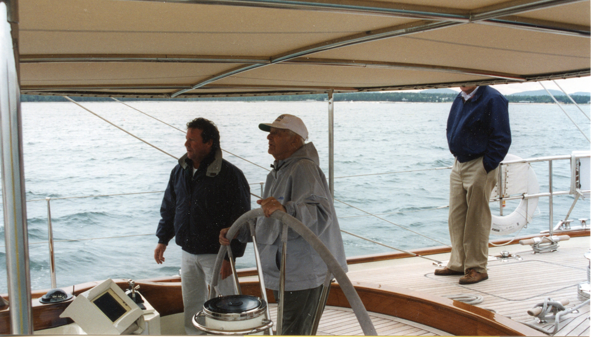 "Olin Stephens at the Helm of ""Rebecca"" with Ralph Warren Stanley Aboard"
