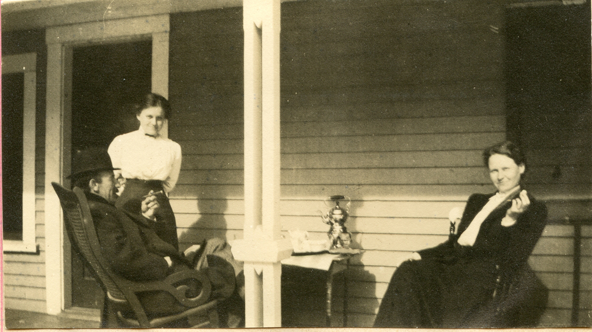 Nell and Seth Thornton and Unidentified Woman Having Tea on the Porch
