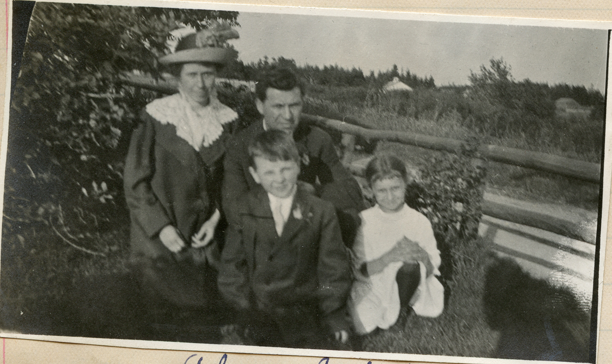 Alice (Carroll) Young and Fred Young with children