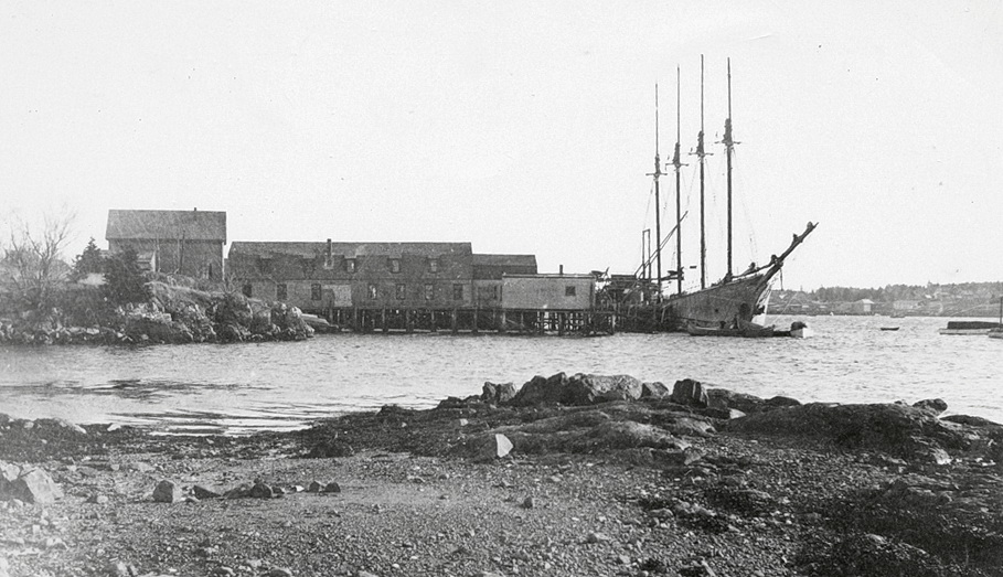 Wharves and Buildings at Clark Point - Schooner Theoline Unloading Coal at J.N. Mills