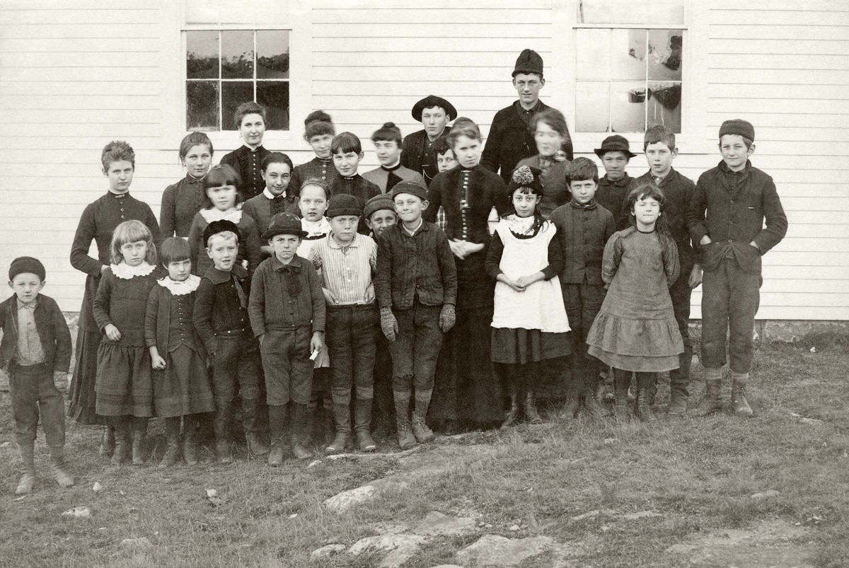 Group Photo of Teacher and Students, Including Seven Carroll Children, at the Norwood Cove School