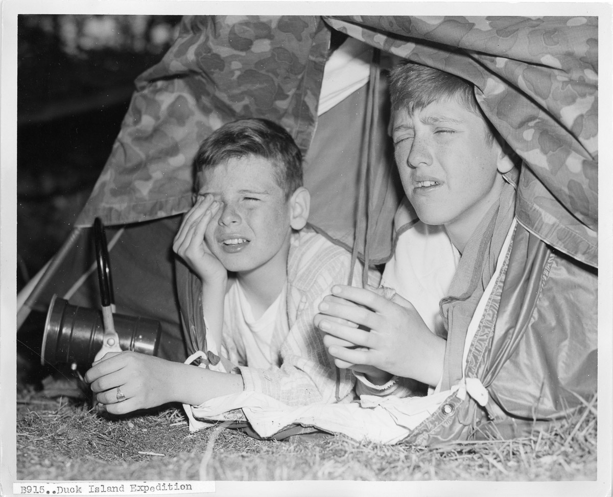 """George Harrison and Bennie Long in a """"pup tent"""""""