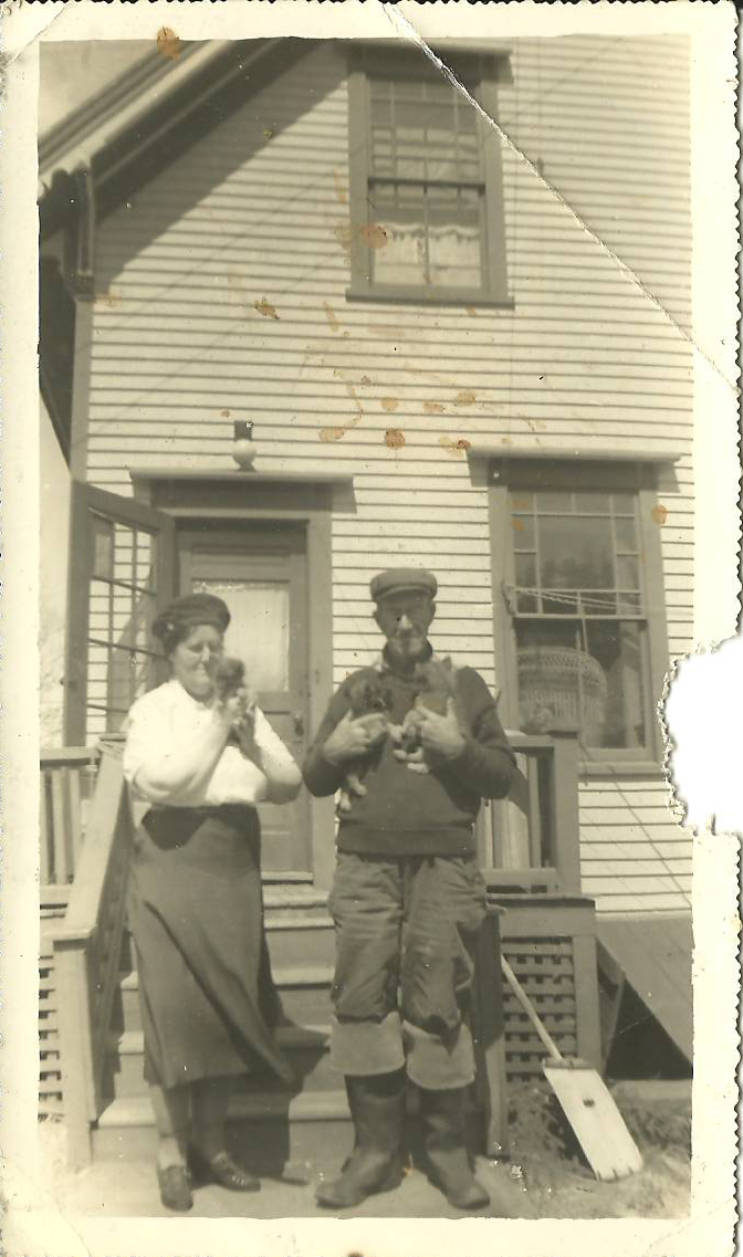 Lottie R. King and Howard Milton Reed Holding Animals