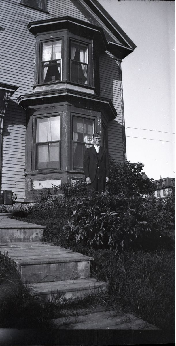 Malcolm S. Ward in front of Unknown House