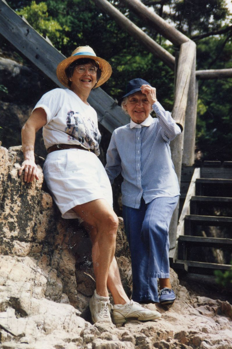 Nan Kellam with a Friend on the Shore of Placentia Island
