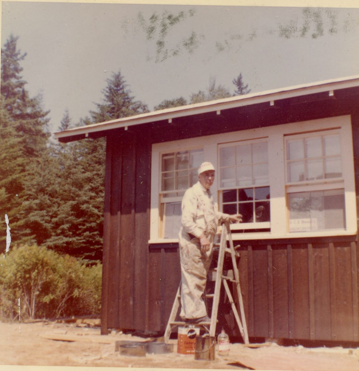 Raymond Whitmore in front of The Field House