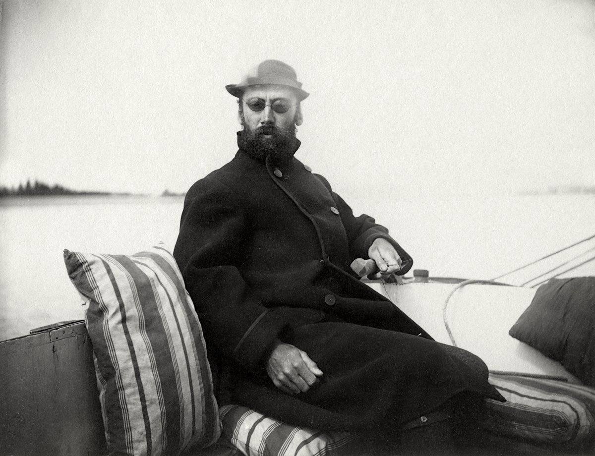 "Henry Lathrop Rand as ""Solomon Levi"" at the helm of his catboat Lanita"