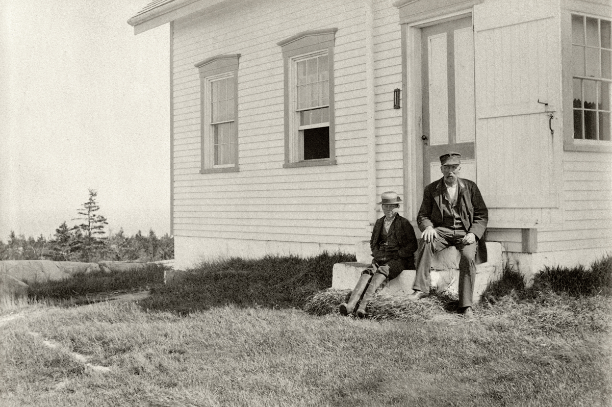 Capt. Howard P. Robbins and Child at Baker Island Light