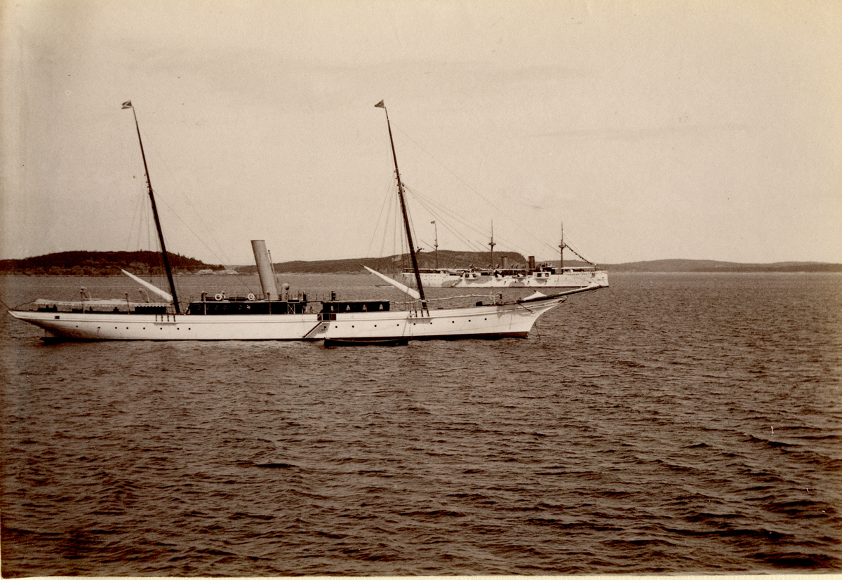 Unknown Yacht with USS Philadelphia in Background