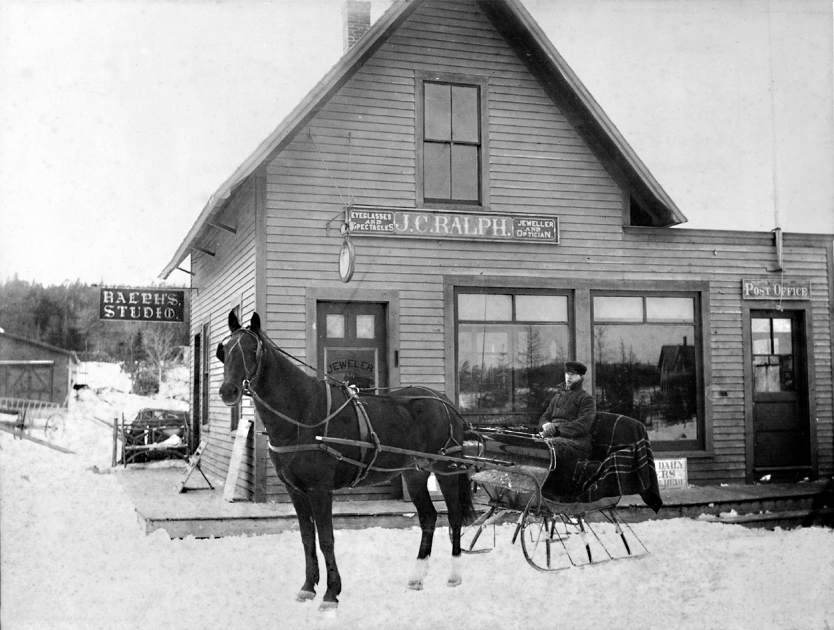 Wilford Howard Kittredge in a Sleigh at J.C. Ralph's Studio & Store and Southwest Harbor Post Office