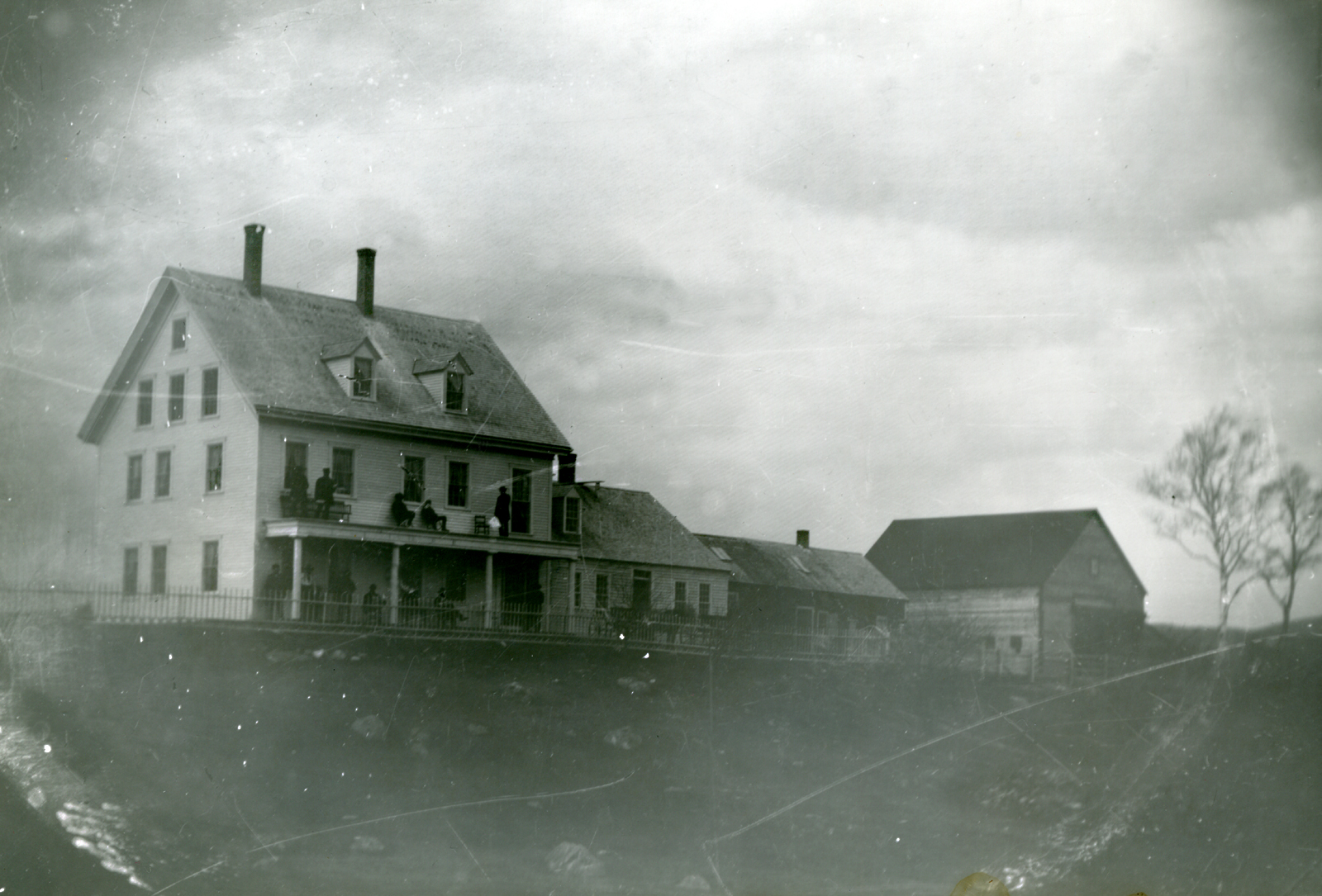 The Freeman House with People on Porch and Balcony