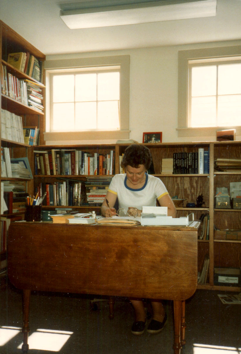 Librarian Meredith Hutchins at Her Desk in the Library