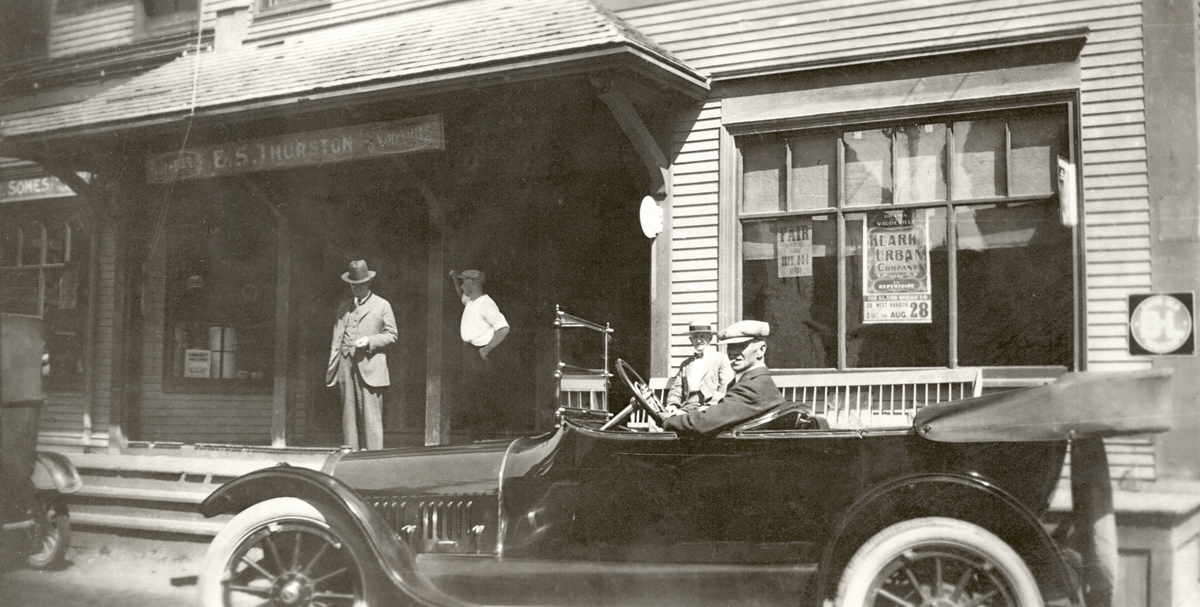 Arthur L. Somes at the Wheel of his Automobile at the First Odd Fellows Building, Southwest Harbor