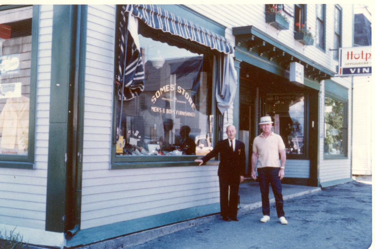 Raymond Percival Somes and his son-in-law, Russell Ernest Ball, in front of Raymond's store in the Second Odd Fellows Building
