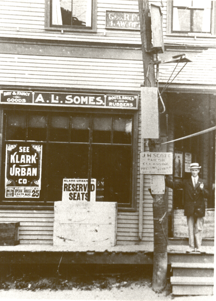 Arthur L. Somes on the Steps of his Store in the First Odd Fellows Building, Southwest Harbor  - Before 1922