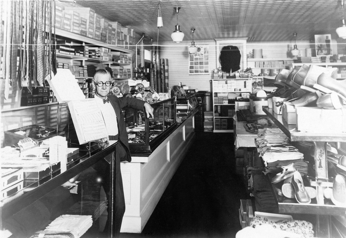 Arthur L. Somes at the Counter of A.L. Somes & Son in the Second Odd Fellows Building, Southwest Harbor