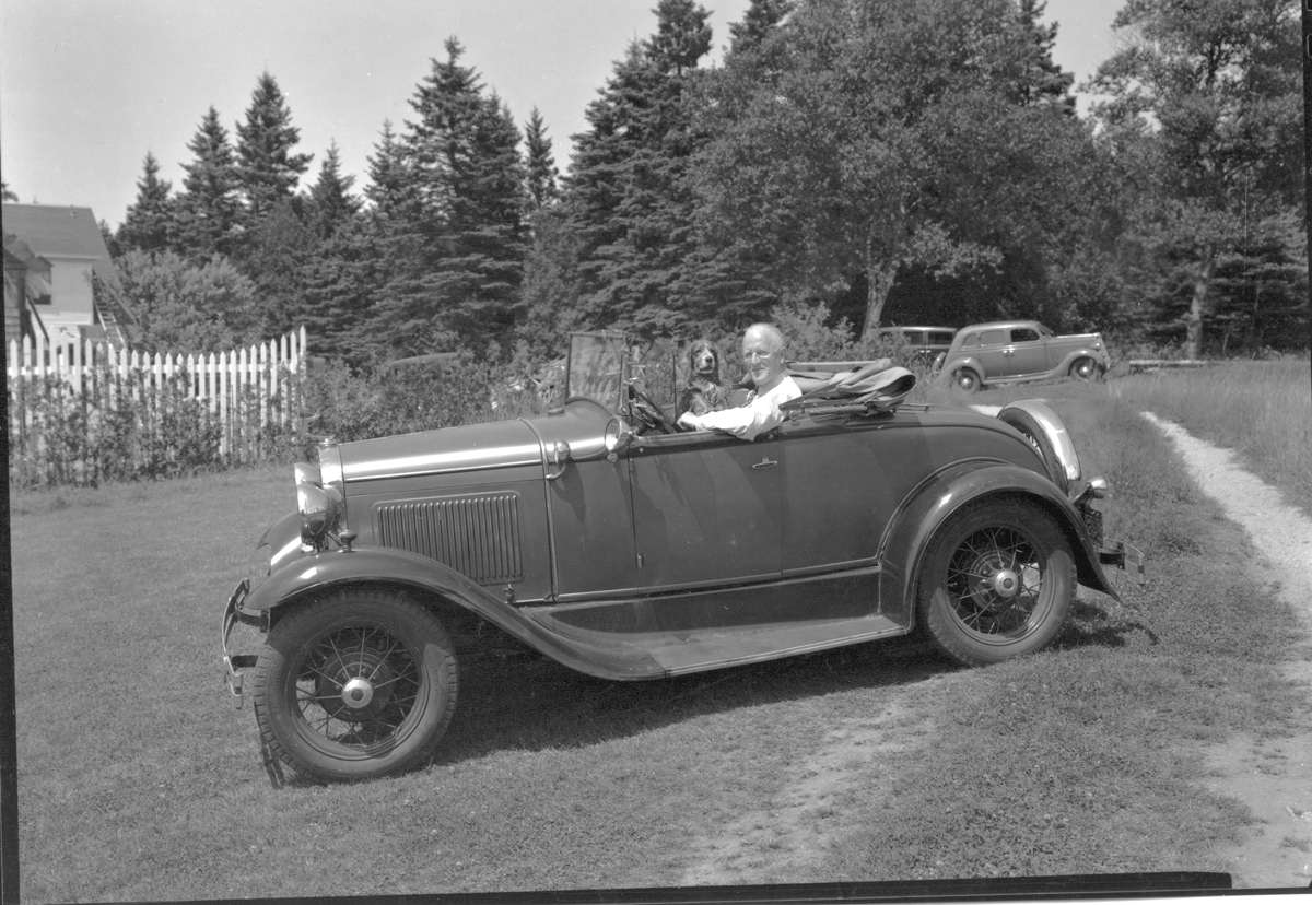 Kenneth Usher and His Dog in his 1930 Ford Model A Roadster