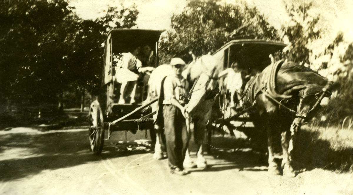 Christopher Wendell Lawlor with daughter, Rosemary Lawlor and Two Ice Wagons with Percherons