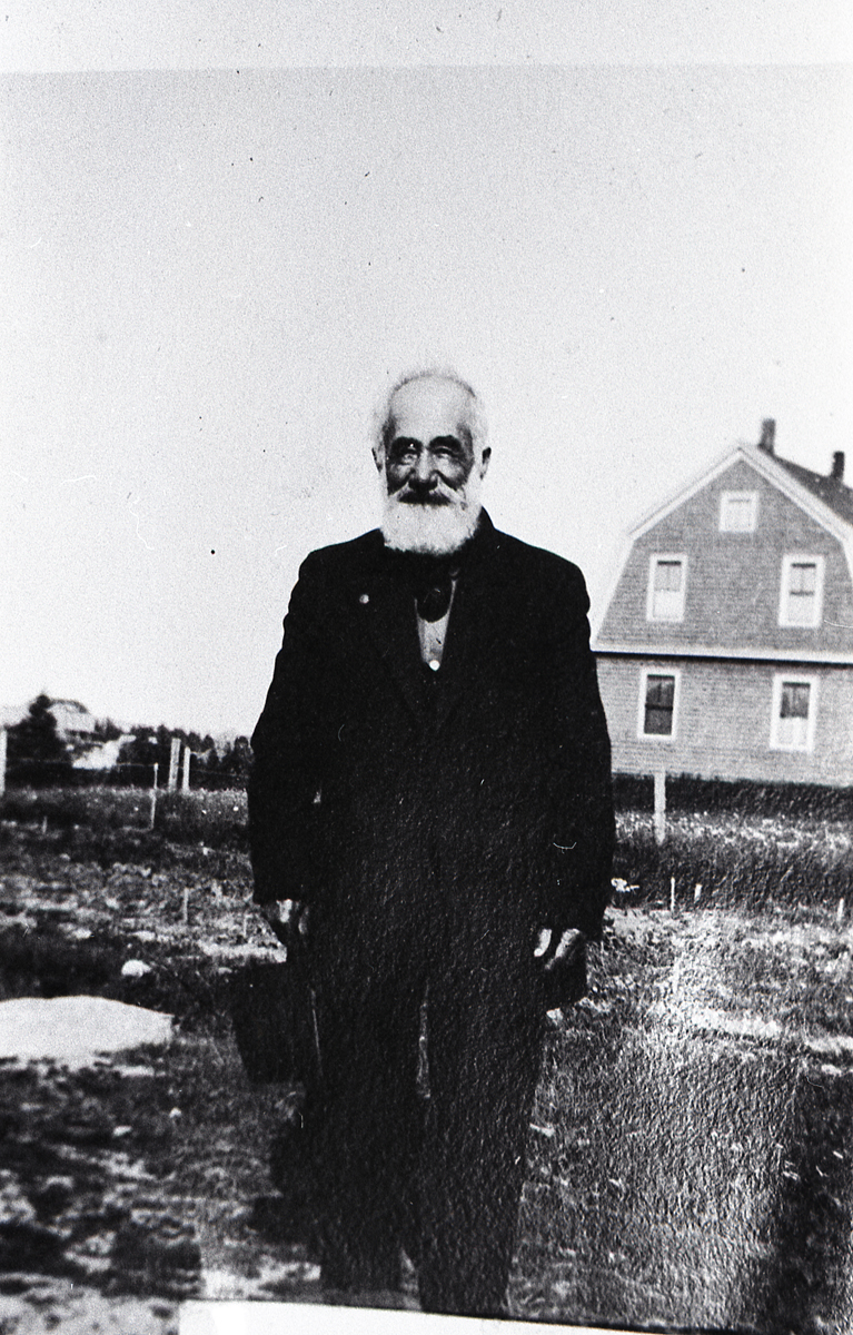Andrew J. Butler in Front of His House