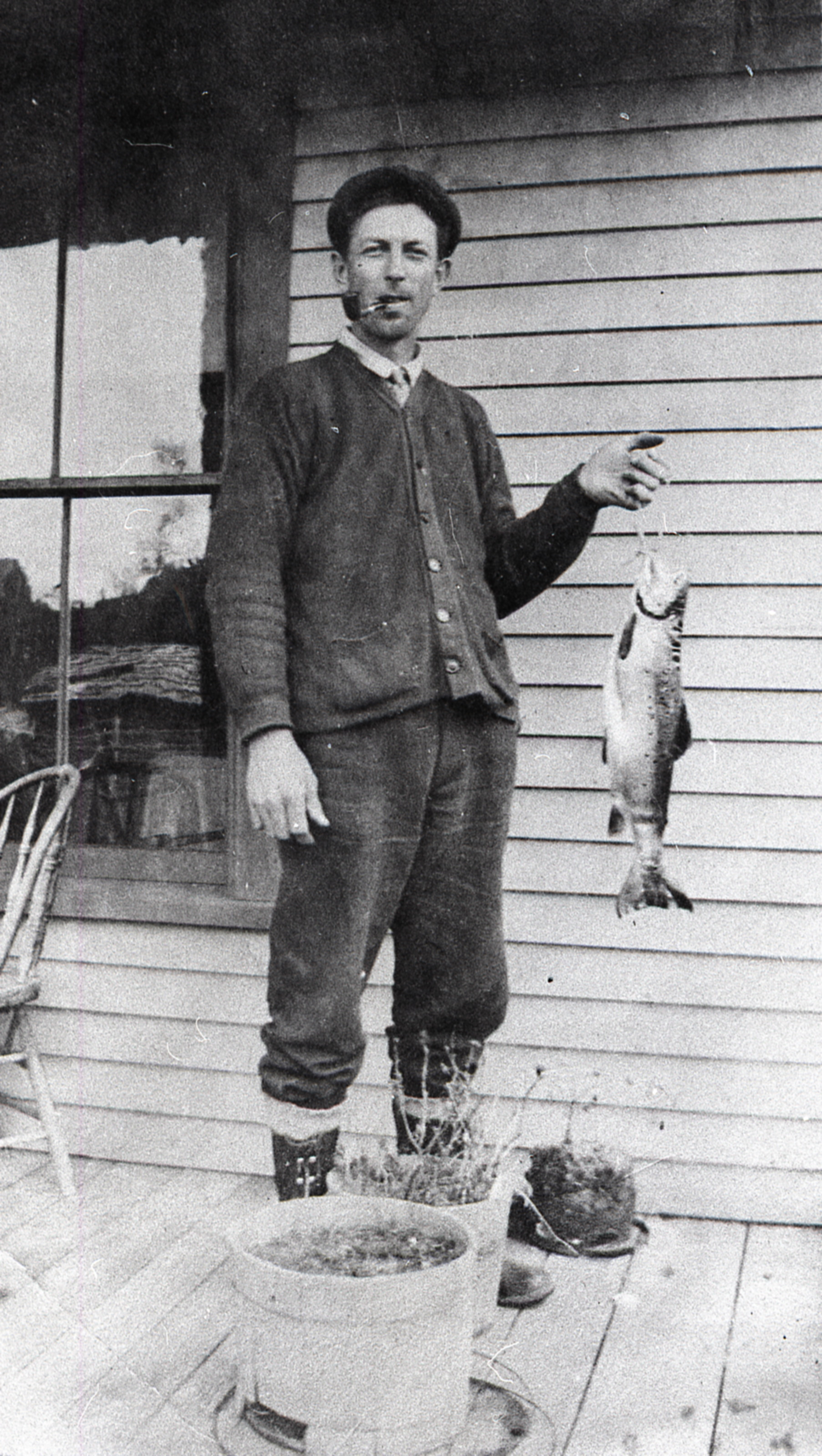 Fred Sidney Mayo holding a fish