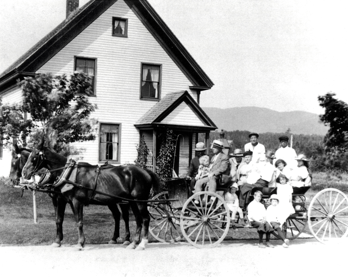 William Edgar Herrick Family Party with Summer People in a Buckboard at the John R. Tinker House