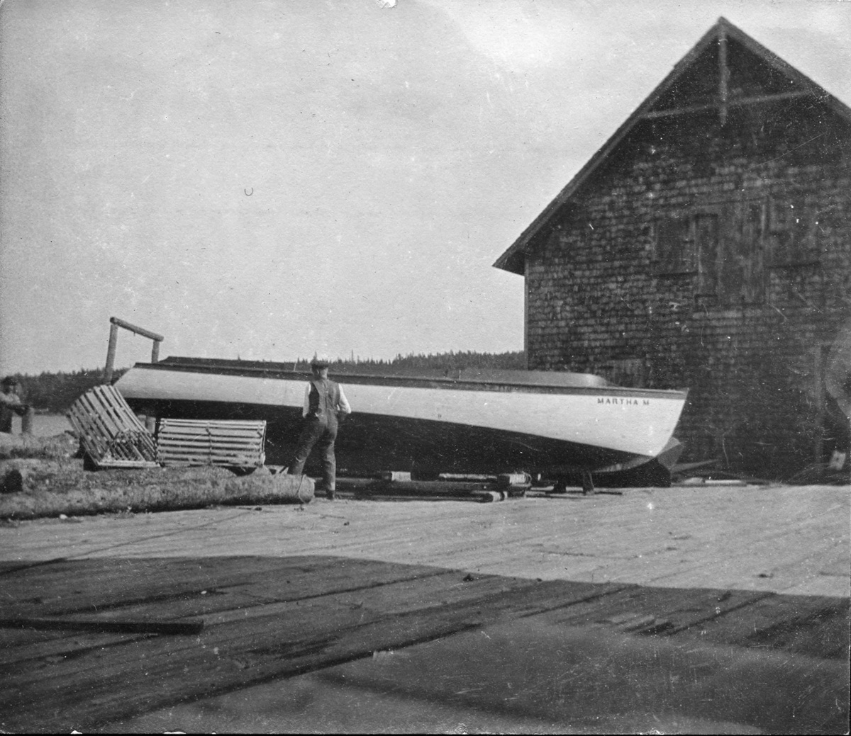 Simeon Holden Mayo and the Martha M. on the wharf at his Boat Shop