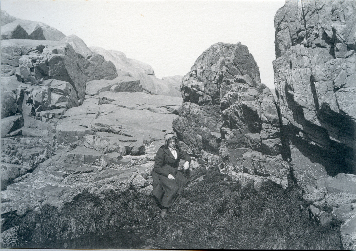 Rocks on Shore with Unknown Woman