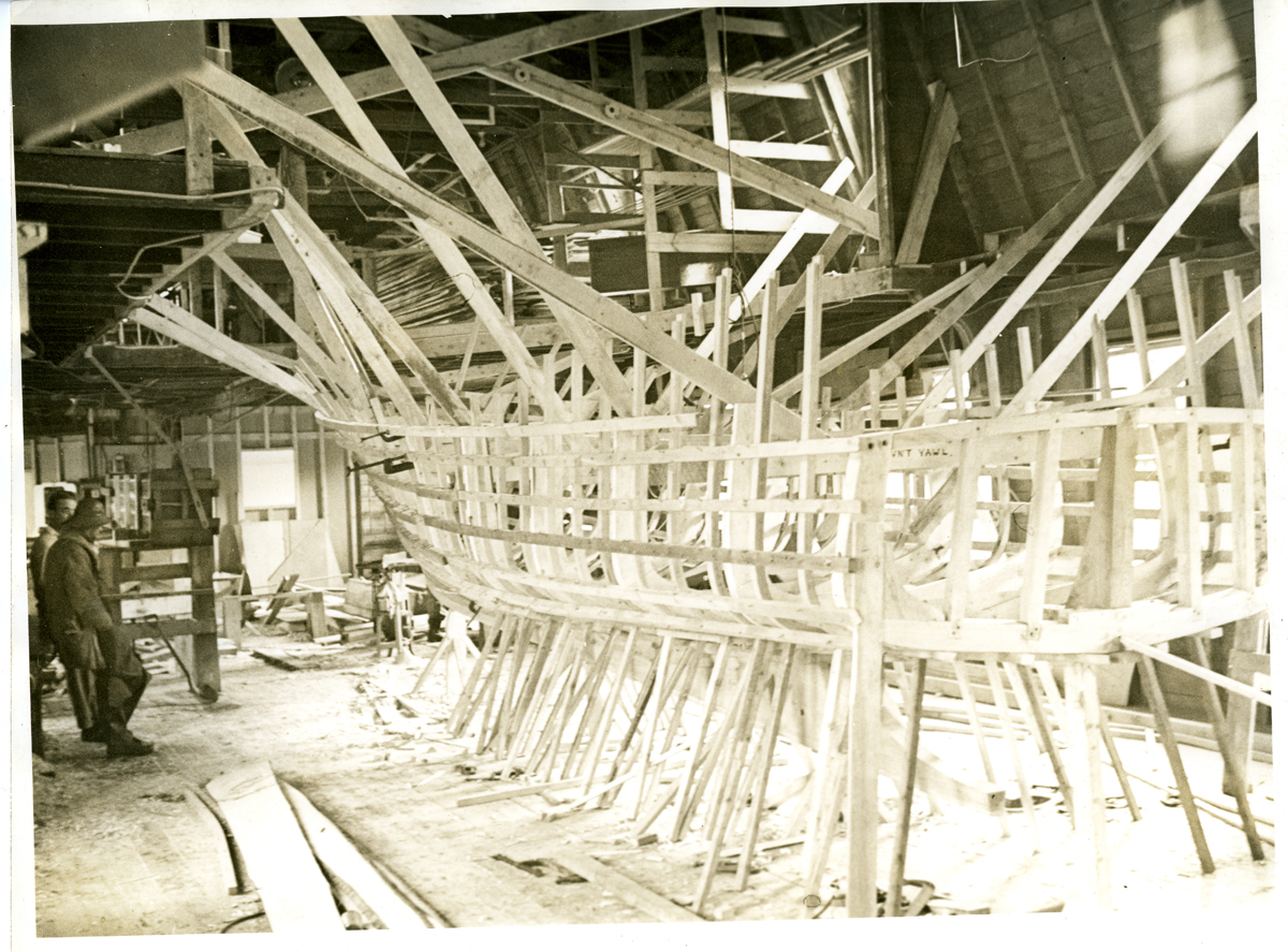 Lennox L. Bink Sargent and Chester Warren Stanley with Framework for a Mine Yawl at Southwest Boat Corporation