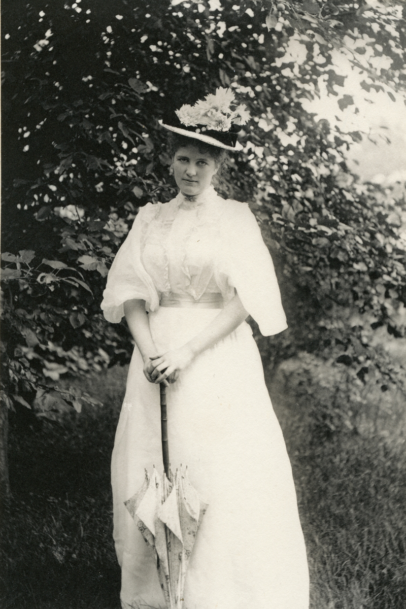 Woman with Parasol and Hat