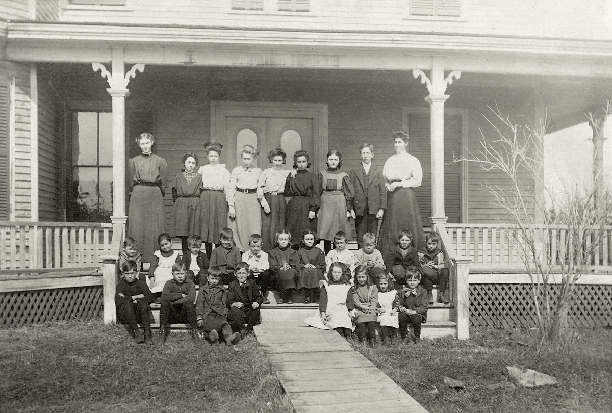 Bessie M. Noyes and Students on the Steps at Ocean House Cottage/Annex